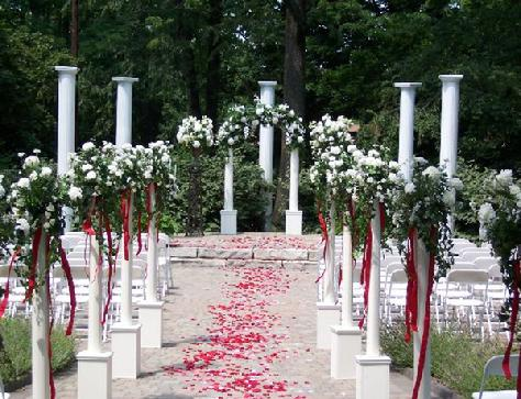 outside rental decor with floral arch - Wedding Decor Rentals